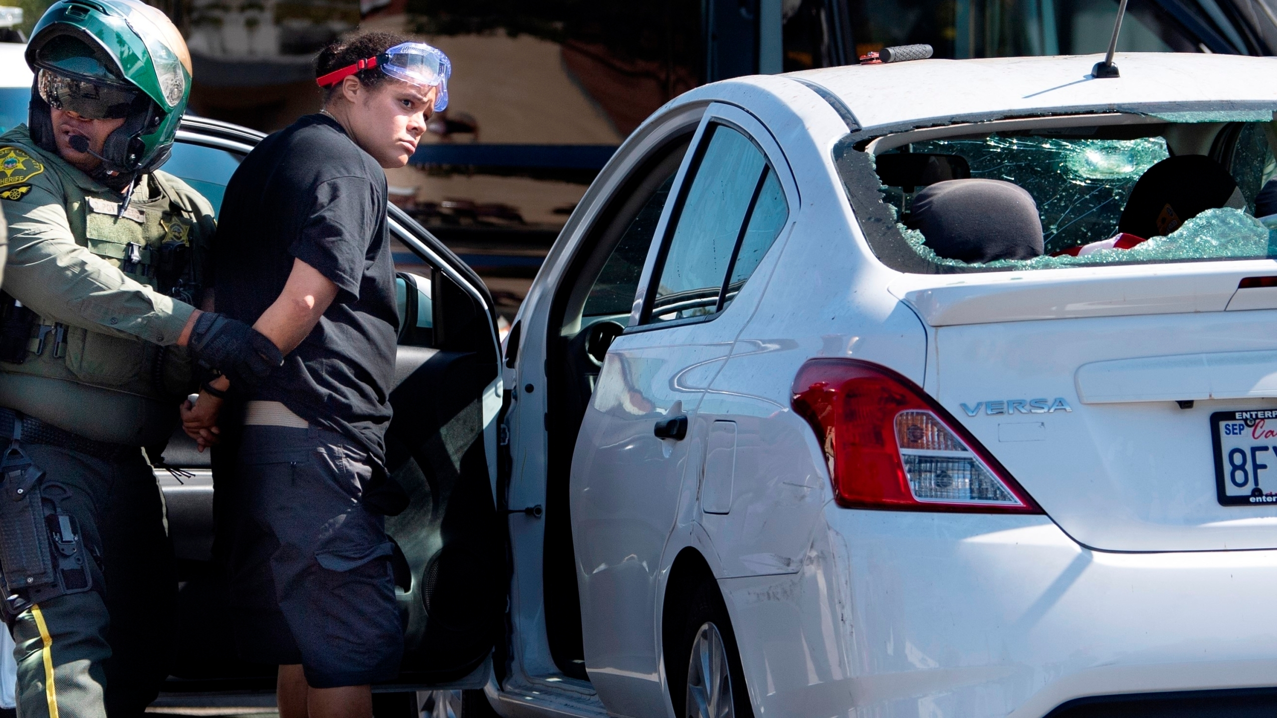 Tatiana Turner is taken into custody after witnesses said she drove her car into a crowd of protesters in Yorba Linda, Calif., on Sept. 26, 2020.(Mindy Schauer/The Orange County Register via AP)
