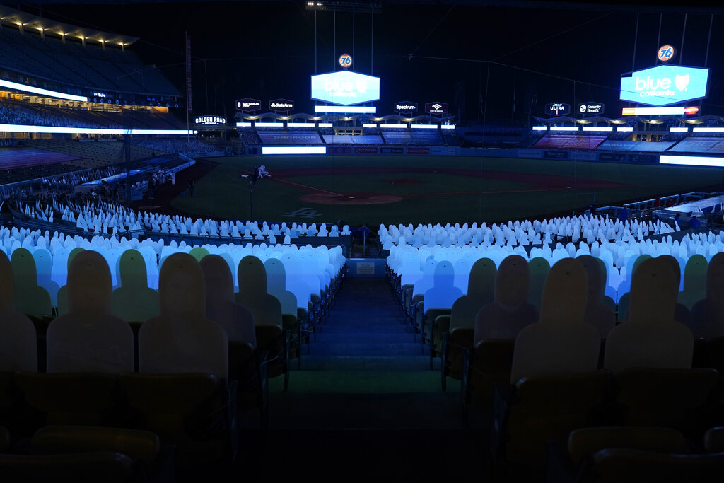 Players leave the field after a power outage during the seventh inning of a baseball game between the Los Angeles Angels and the Los Angeles Dodgers Sept. 26, 2020, in Los Angeles. (AP Photo/Ashley Landis)