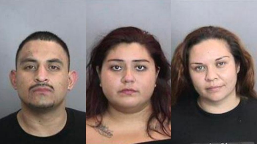 Omar Sanchez, left, Yesenia Escareno, center, and Adriana Gomez, right, are seen in booking photos released by the Anaheim Police Department.