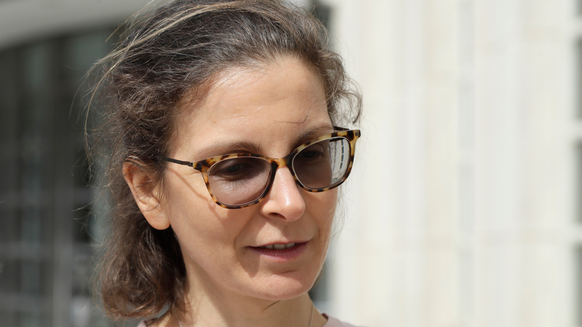 In this April 8, 2019, file photo, Seagram's liquor fortune heiress Clare Bronfman leaves Brooklyn Federal Court, in New York. Bronfman, the wealthy benefactor of Keith Raniere, the disgraced leader of a self-improvement group in upstate New York convicted of turning women into sex slaves branded with his initials, will be in court, on Wednesday, Sept. 30, 2020, for sentencing on federal conspiracy charges. (AP Photo/Mark Lennihan, File)