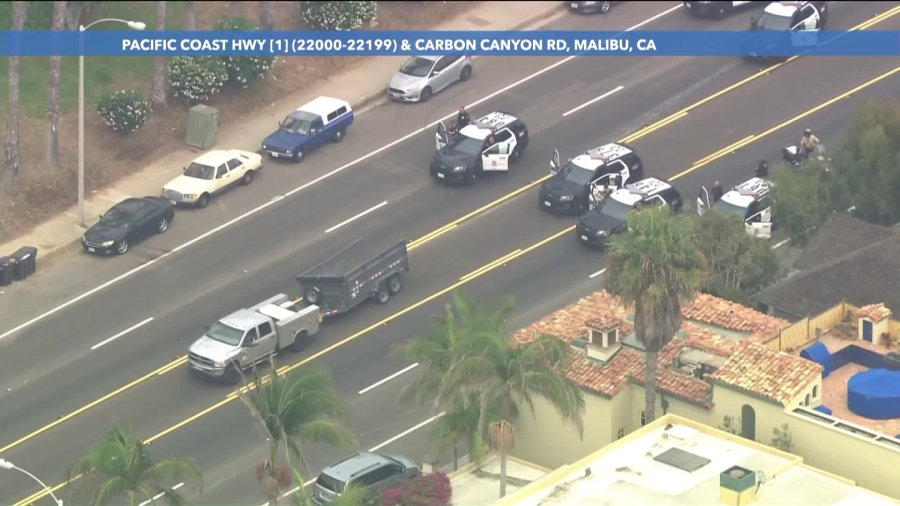 Officers try to detain the driver of a truck near Carbon Canyon Road in Malibu on Sept. 8, 2020. (Sky 5)