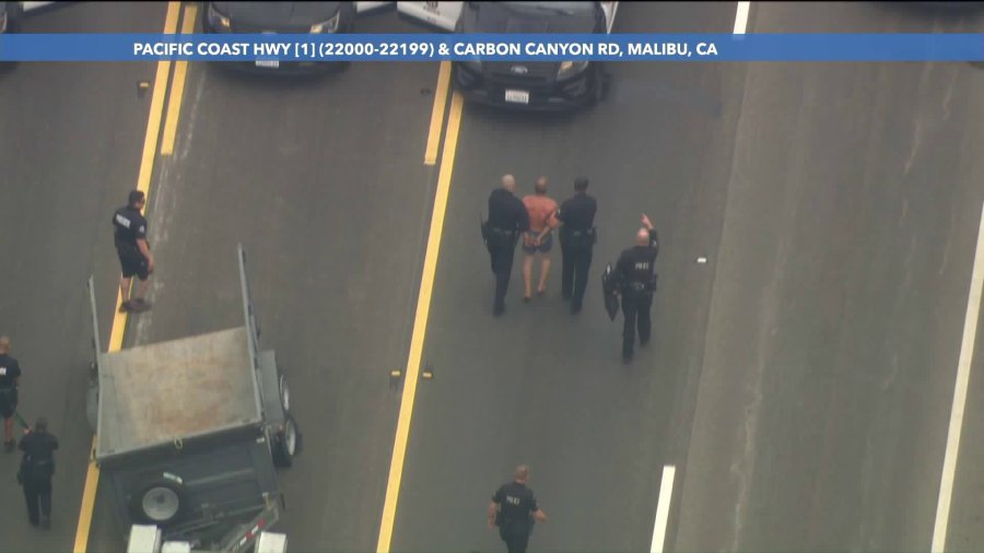 A reckless driving suspect is taken into custody after a pursuit and standoff with LAPD on Sept. 8, 2020. (KTLA)
