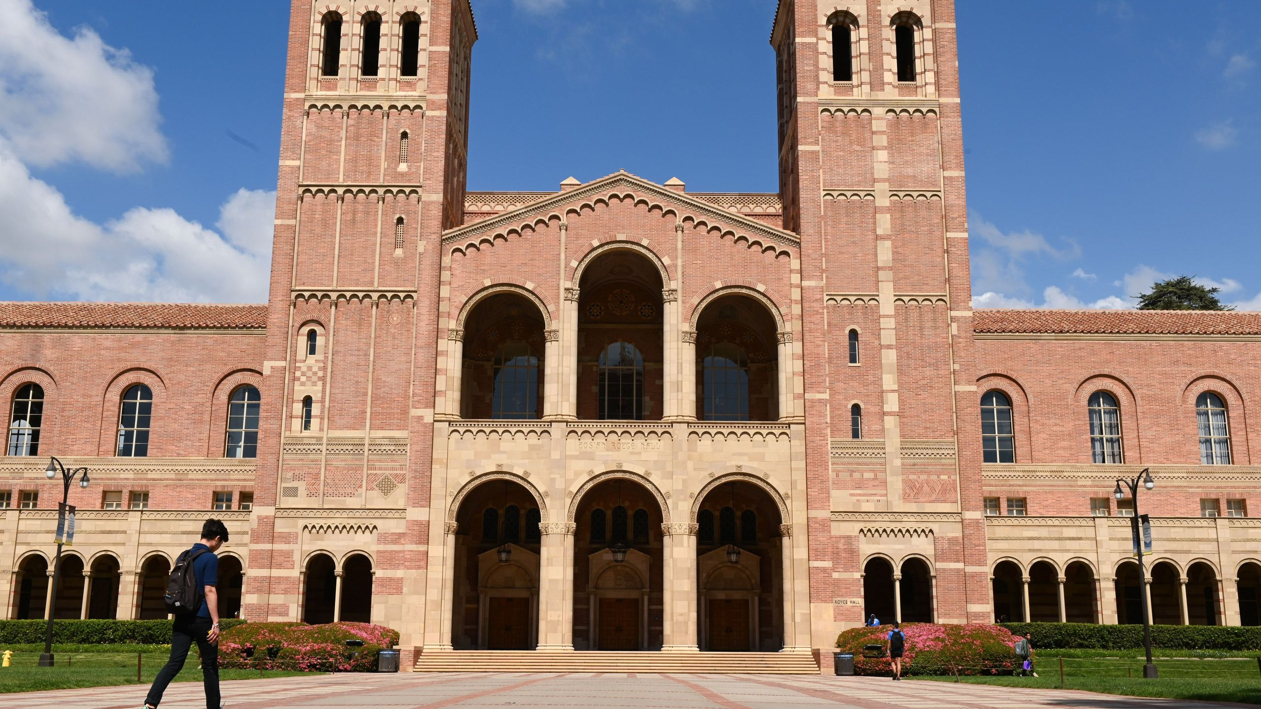 A student walks toward Royce Hall on the campus of UCLA on March 11, 2020. (ROBYN BECK/AFP via Getty Images)