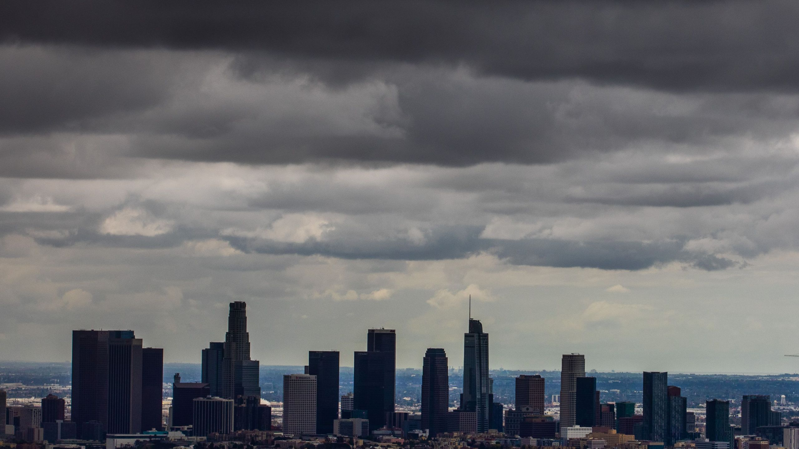 Heavy clouds are seen over downtown Los Angeles skyline from Griffth park on April 5, 2020 in Los Angeles, California. (APU GOMES/AFP via Getty Images)