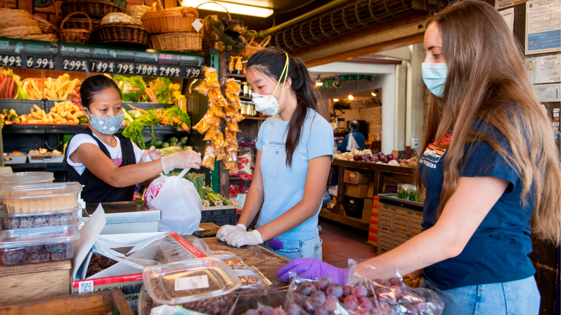 High school students shop for groceries at the Framers Market on 3rd in Los Angeles on May 20, 2020. (VALERIE MACON/AFP via Getty Images)