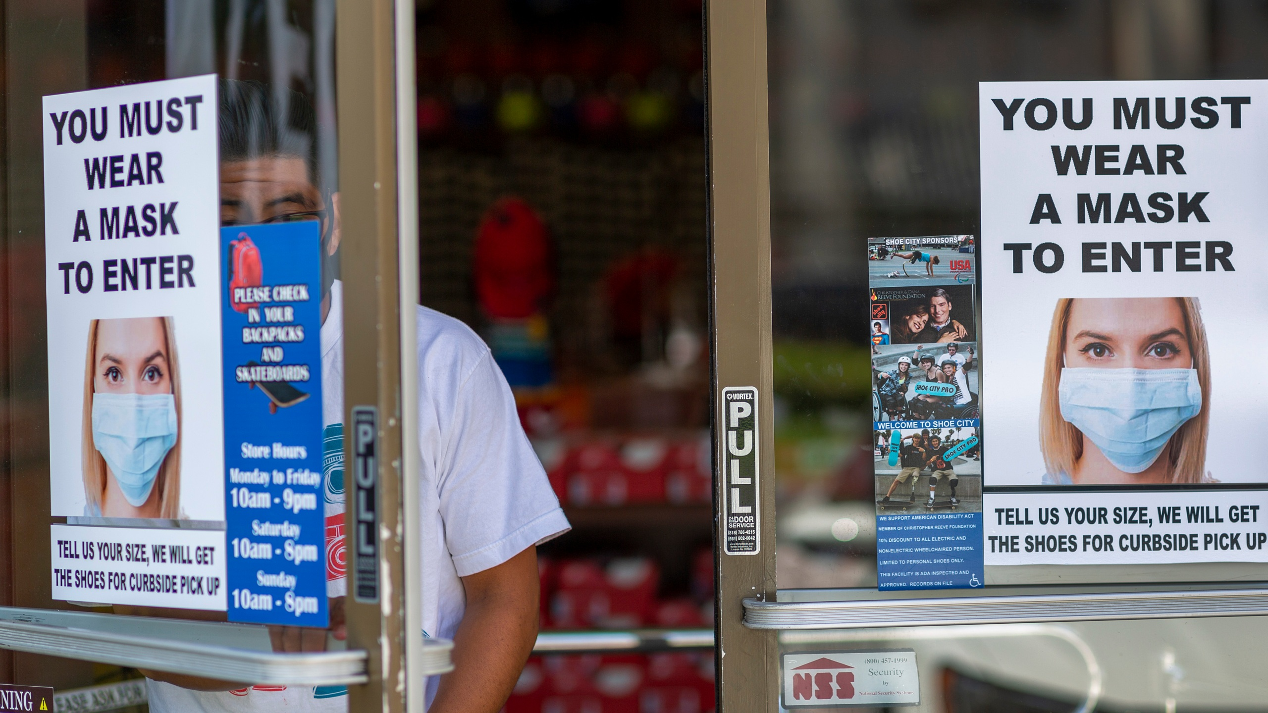 A man exits a store where masks are required for entry on May 27, 2020 in Glendale. (David McNew/Getty Images)