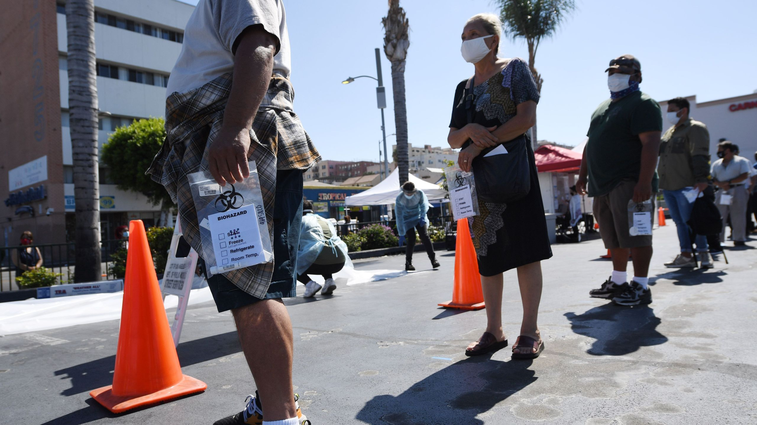 People wait in line at a walk-up coronavirus testing location in Los Angeles on Aug. 10, 2020. (ROBYN BECK/AFP via Getty Images)