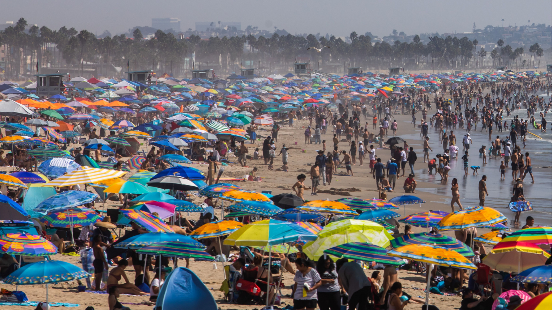 People gather on the beach on the second day of the Labor Day weekend amid a heatwave in Santa Monica on Sept. 6, 2020. (APU GOMES/AFP via Getty Images)