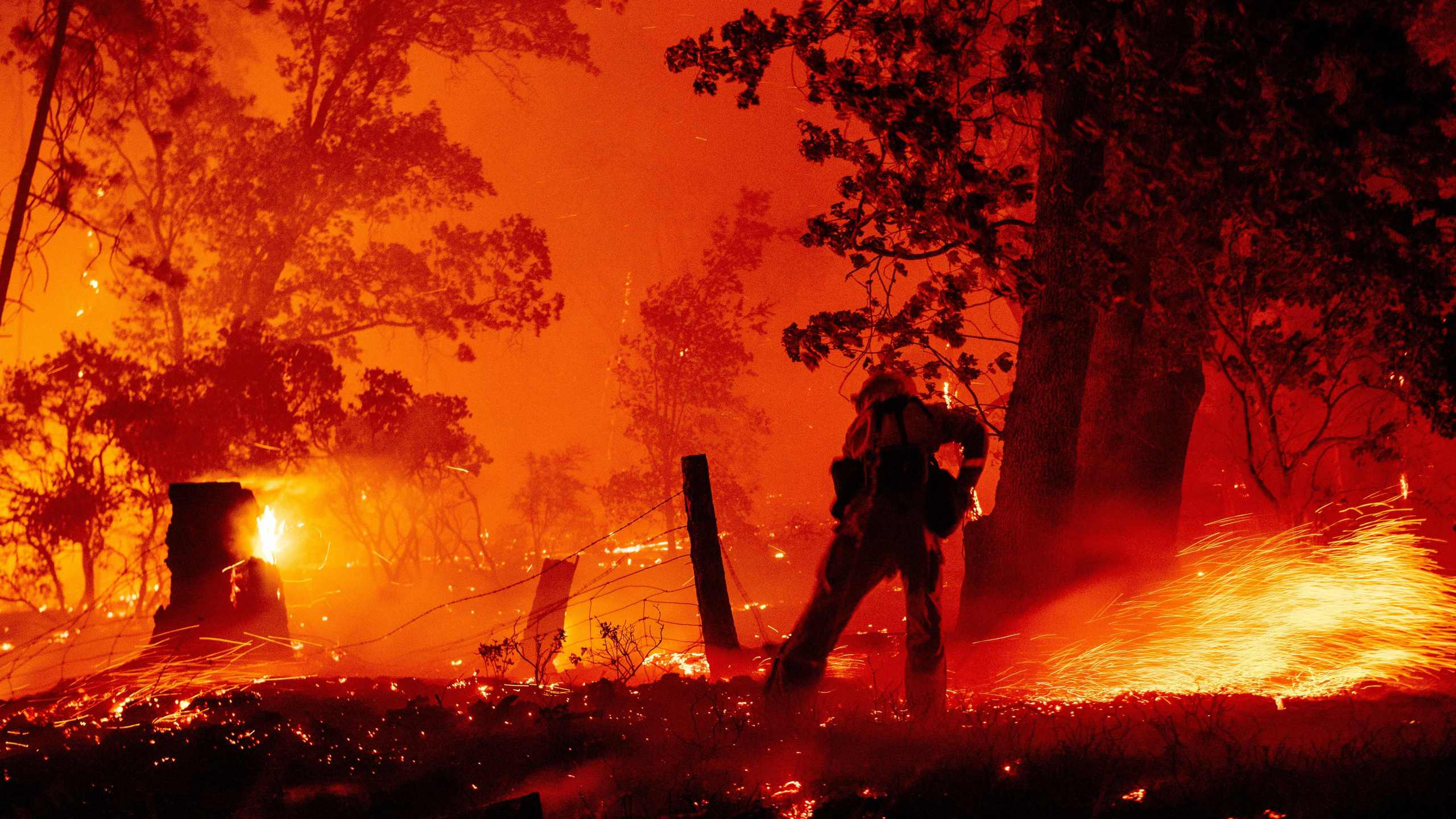 A firefighter works the line as flames push towards homes during the Creek fire in the Cascadel Woods area of unincorporated Madera County, California on September 7, 2020. (Photo by JOSH EDELSON/AFP via Getty Images)