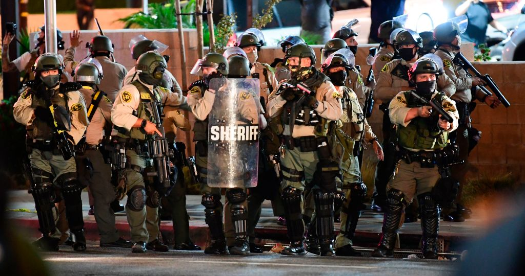 Los Angeles County sheriff's deputies ready to disperse a crowd of demonstrators gathered to protest again in the wake of Dijon Kizzee's killing, outside the South L.A. sheriff's station on Sept. 8, 2020 in Los Angeles, California. (FREDERIC J. BROWN/AFP via Getty Images)