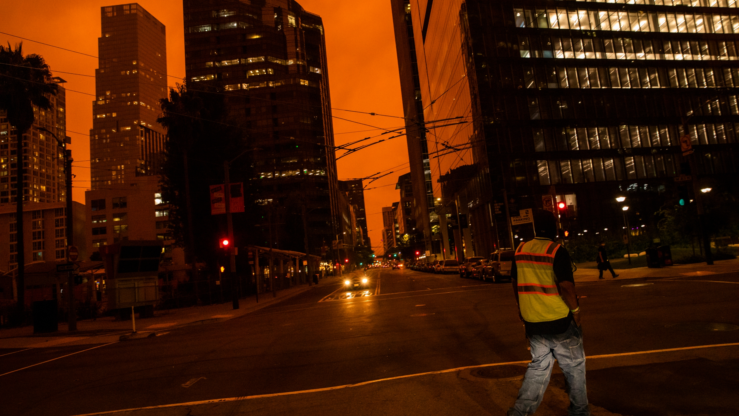 An orange glow is seen over a darkened Howard Street as smoke from various wildfires burning across Northern California mixes with the marine layer on Sept. 9, 2020, in San Francisco. (Philip Pacheco/Getty Images)