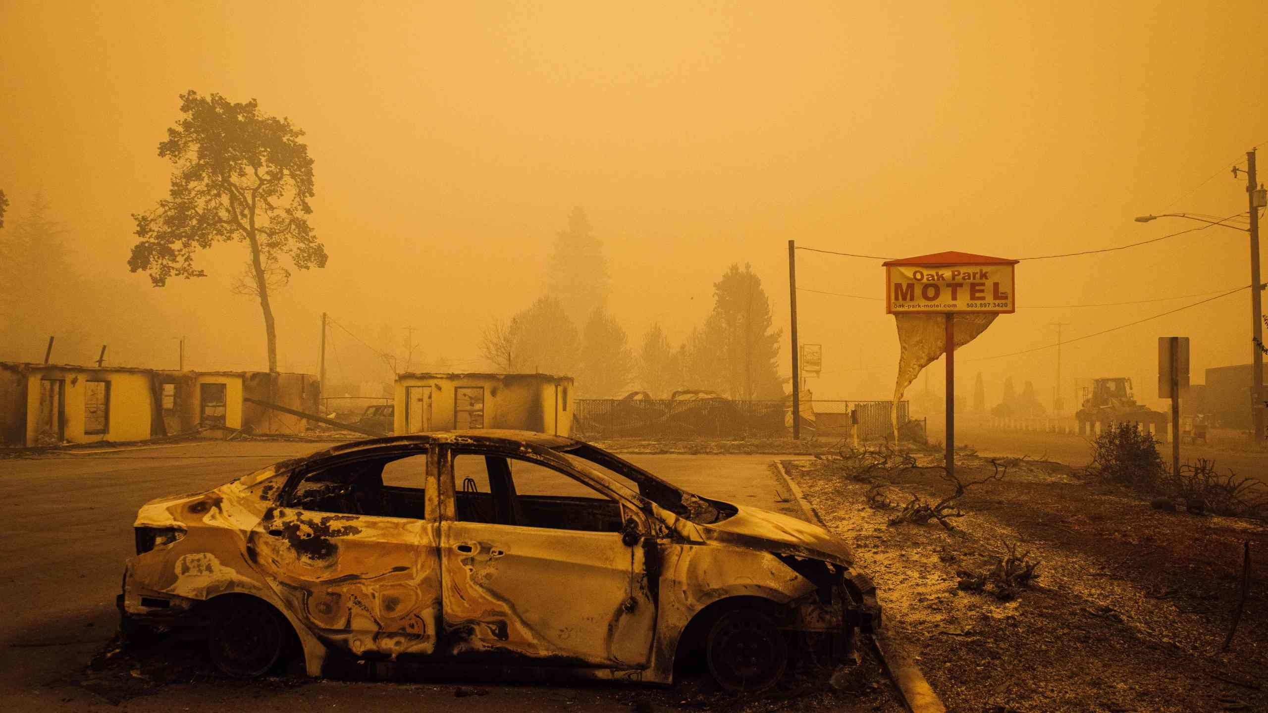 A charred vehicle is seen in the parking lot of the burned Oak Park Motel after the passage of the Santiam Fire in Gates, Oregon, on Sept. 10, 2020. (KATHRYN ELSESSER/AFP via Getty Images)