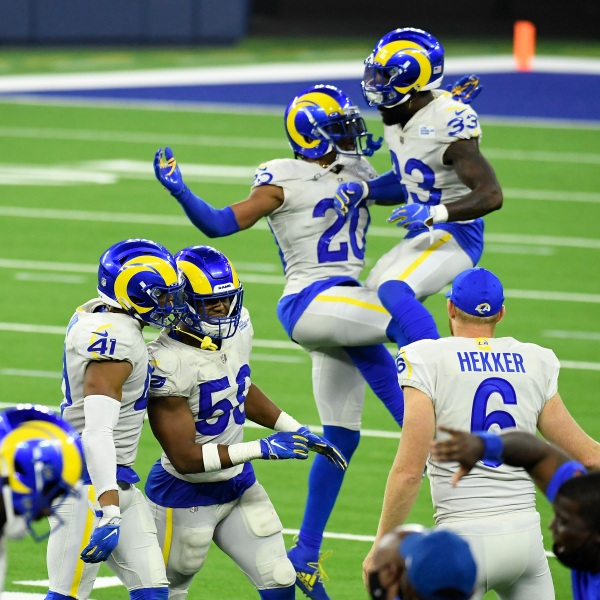 Justin Hollins #58 and Kenny Young #41 of the Los Angeles Rams celebrate after defeating the Dallas Cowboys 20-17 at SoFi Stadium on Sept. 13, 2020, in Inglewood, Calif. (Kevork Djansezian/Getty Images)