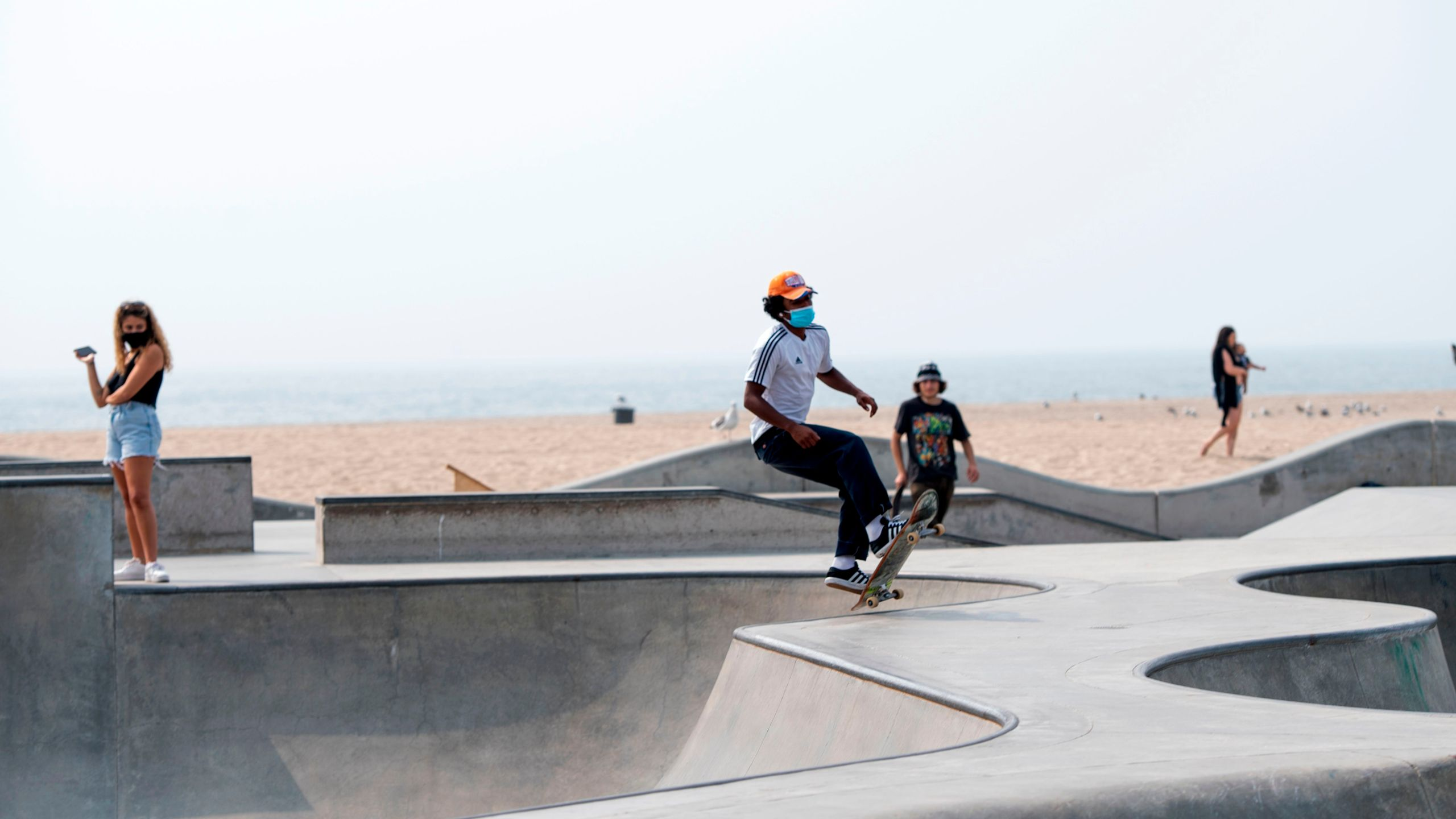A man wearing a face mask skateboards at a skate park in Venice Beach on Sept. 15, 2020. (VALERIE MACON/AFP via Getty Images)