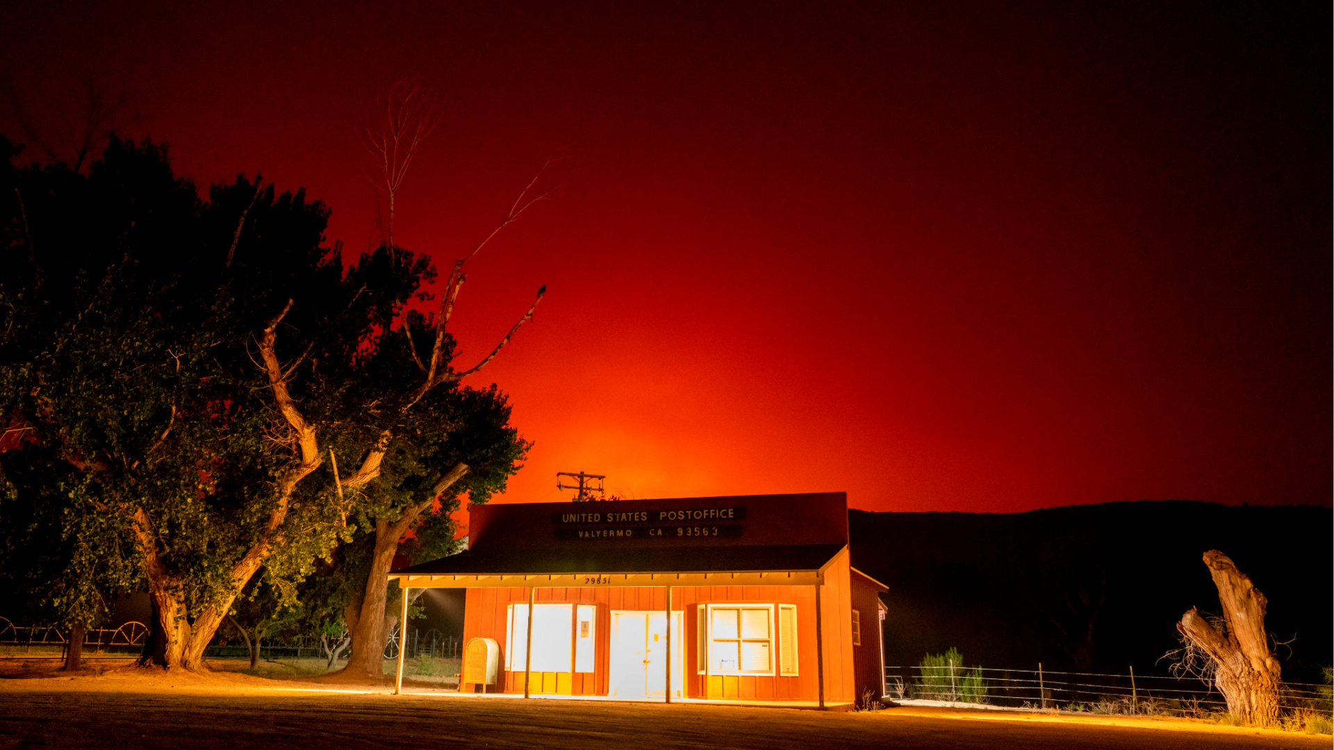 The Bobcat Fire burns above the Valyermo, California, Post Office, Sept. 17, 2020. (Kyle Grillot/AFP via Getty Images)