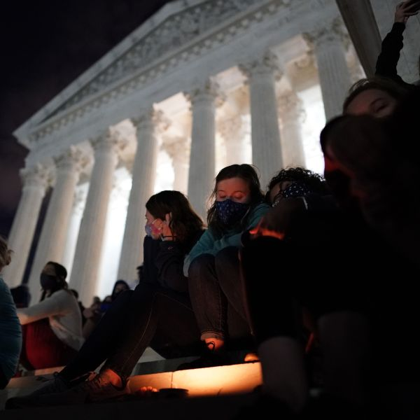 People gather at a makeshift memorial for late Justice Ruth Bader Ginsburg on the steps of the Supreme Court building on Sept. 18, 2020. (Alex Edelman / AFP / Getty Images)
