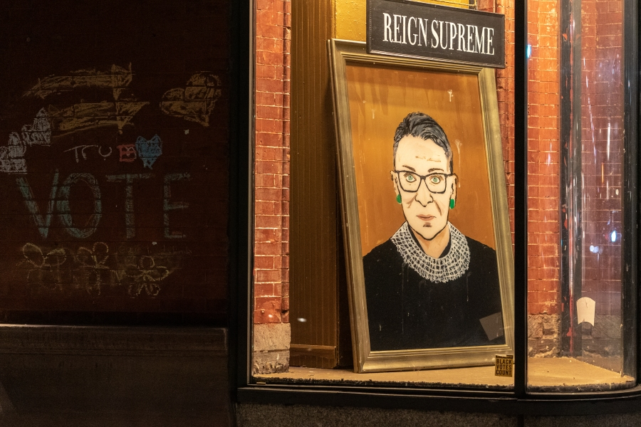 A portrait of Supreme Court Justice Ruth Bader Ginsburg is displayed at a storefront on Sept. 19, 2020 in New York, New York. (Jeenah Moon/Getty Images)