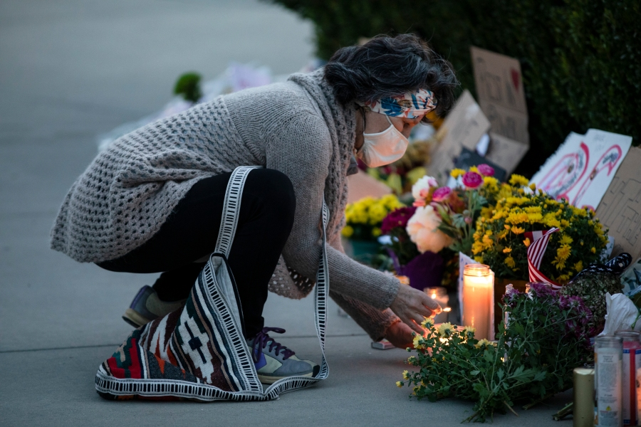 A woman lights candles in front of the U.S. Supreme Court in honor of Supreme Court Justice Ruth Bader Ginsburg on Sept. 19, 2020 in Washington, D.C. (Samuel Corum/Getty Images)