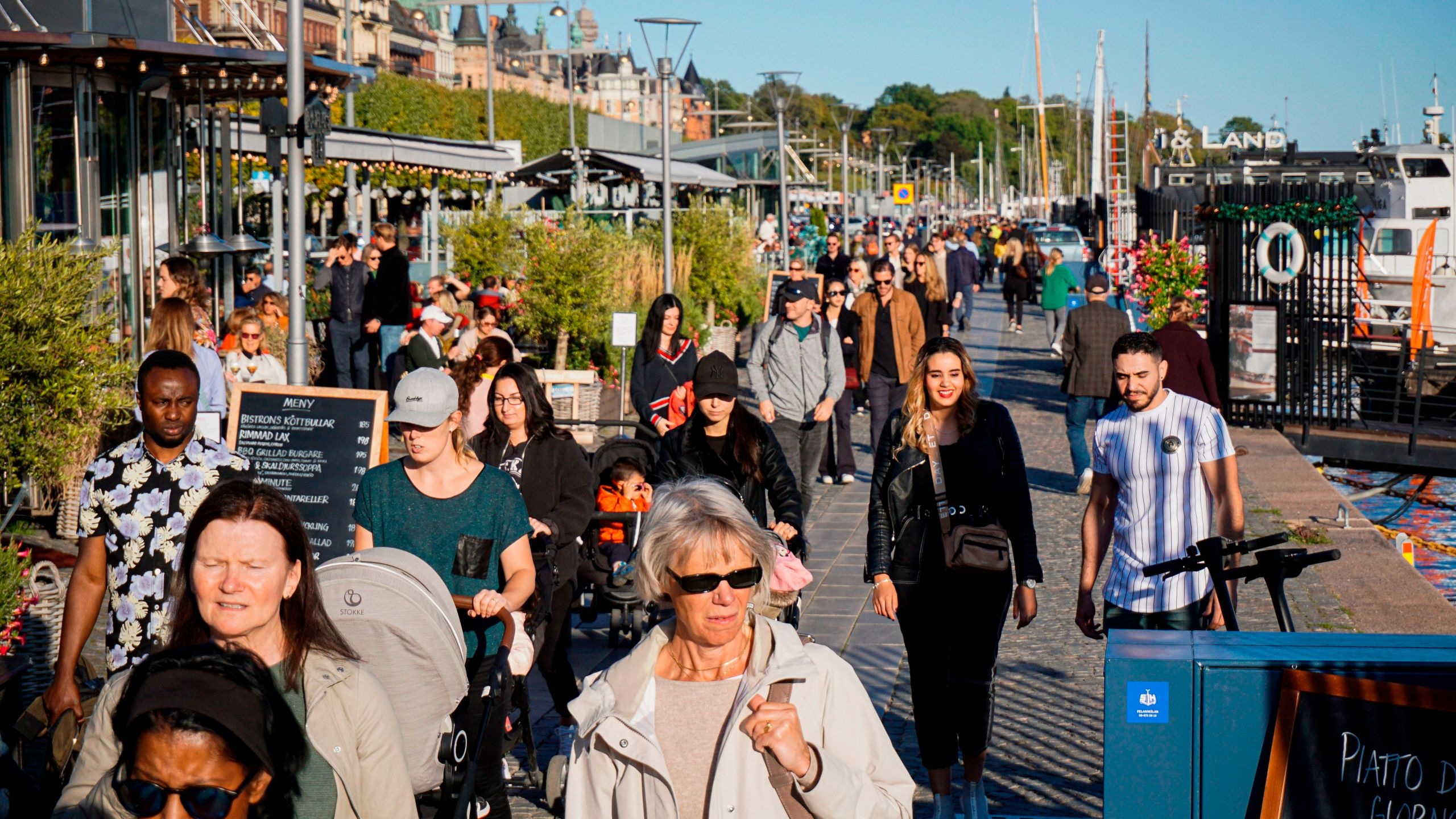 People walk on Stranvagen in Stockholm on Sept. 19, 2020, during the novel coronavirus COVID-19 pandemic. (Jonathan NACKSTRAND/AFP via Getty Images)