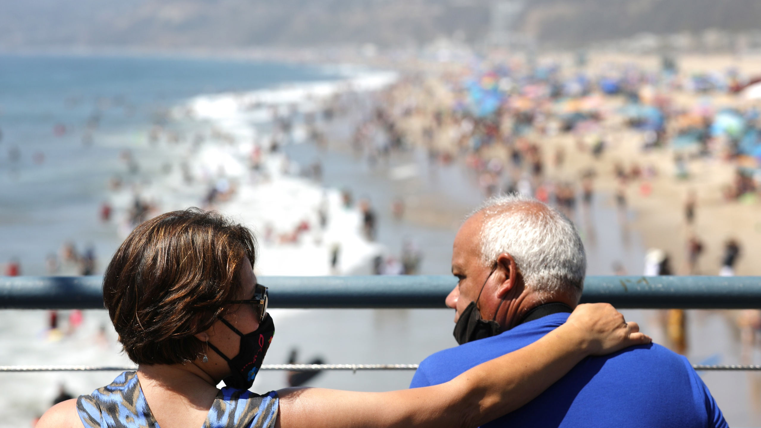 People sit on the Santa Monica pier as others gather on the beach on the first day of the Labor Day weekend on Sept. 5, 2020 in Santa Monica. (Mario Tama/Getty Images)