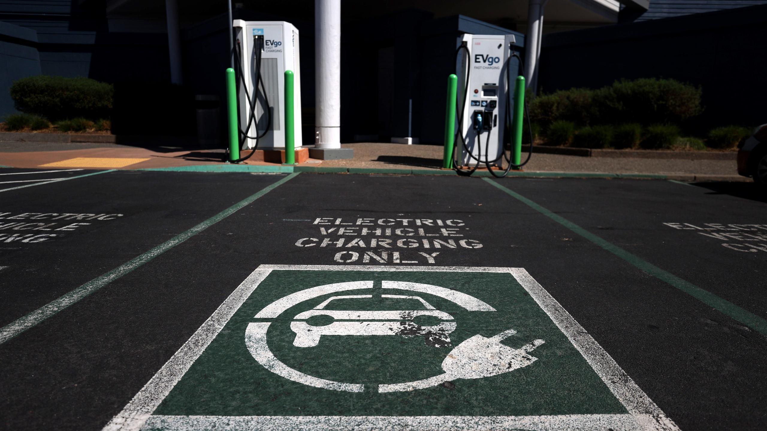 An electric car charges on Sept. 23, 2020, in Corte Madera, California. (Justin Sullivan/Getty Images)