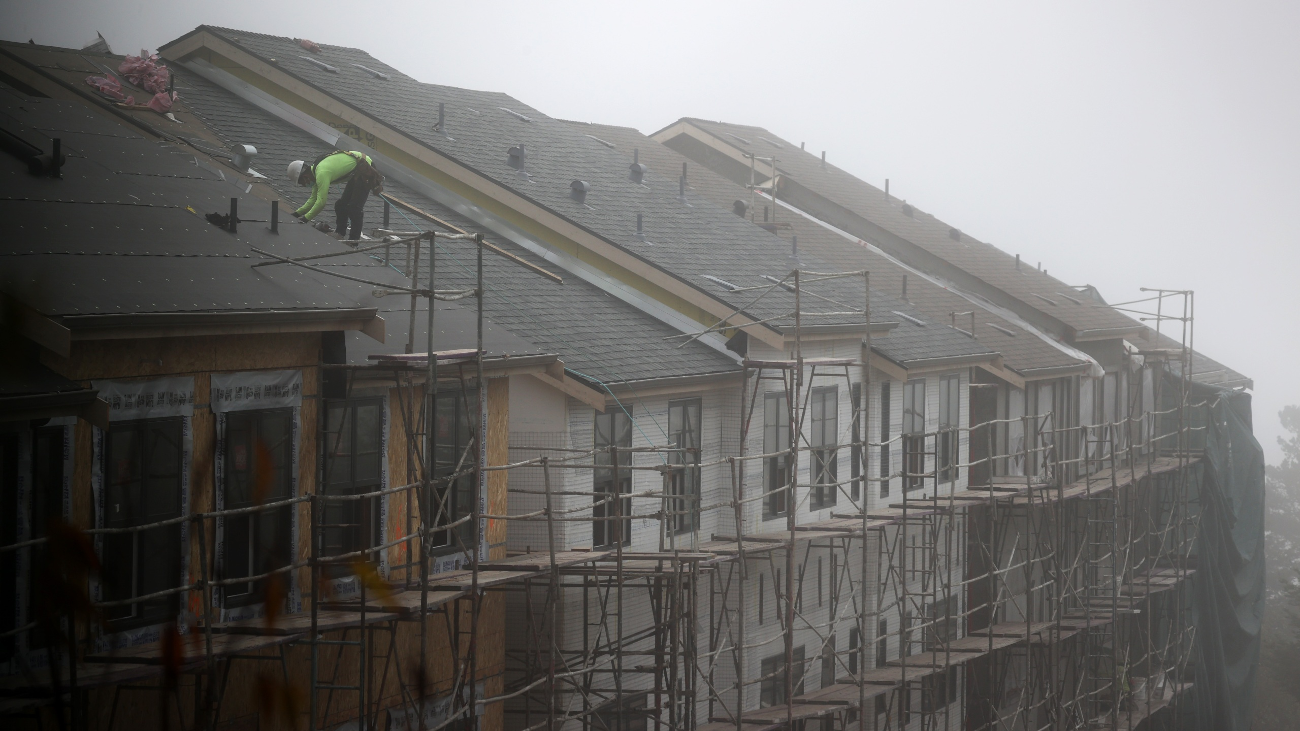 A worker stands on the roof of a new home under construction on September 24, 2020 in South San Francisco. Justin Sullivan/Getty Images)