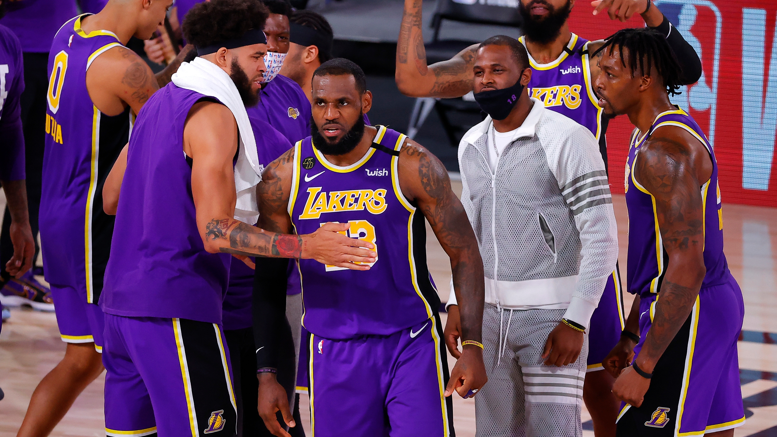 LeBron James #23 of the Los Angeles Lakers celebrates with teammates after their win against the Denver Nuggets in Game Five of the Western Conference Finals during the 2020 NBA Playoffs at AdventHealth Arena at the ESPN Wide World Of Sports Complex on Sept. 26, 2020 in Lake Buena Vista, Florida. (Kevin C. Cox/Getty Images)