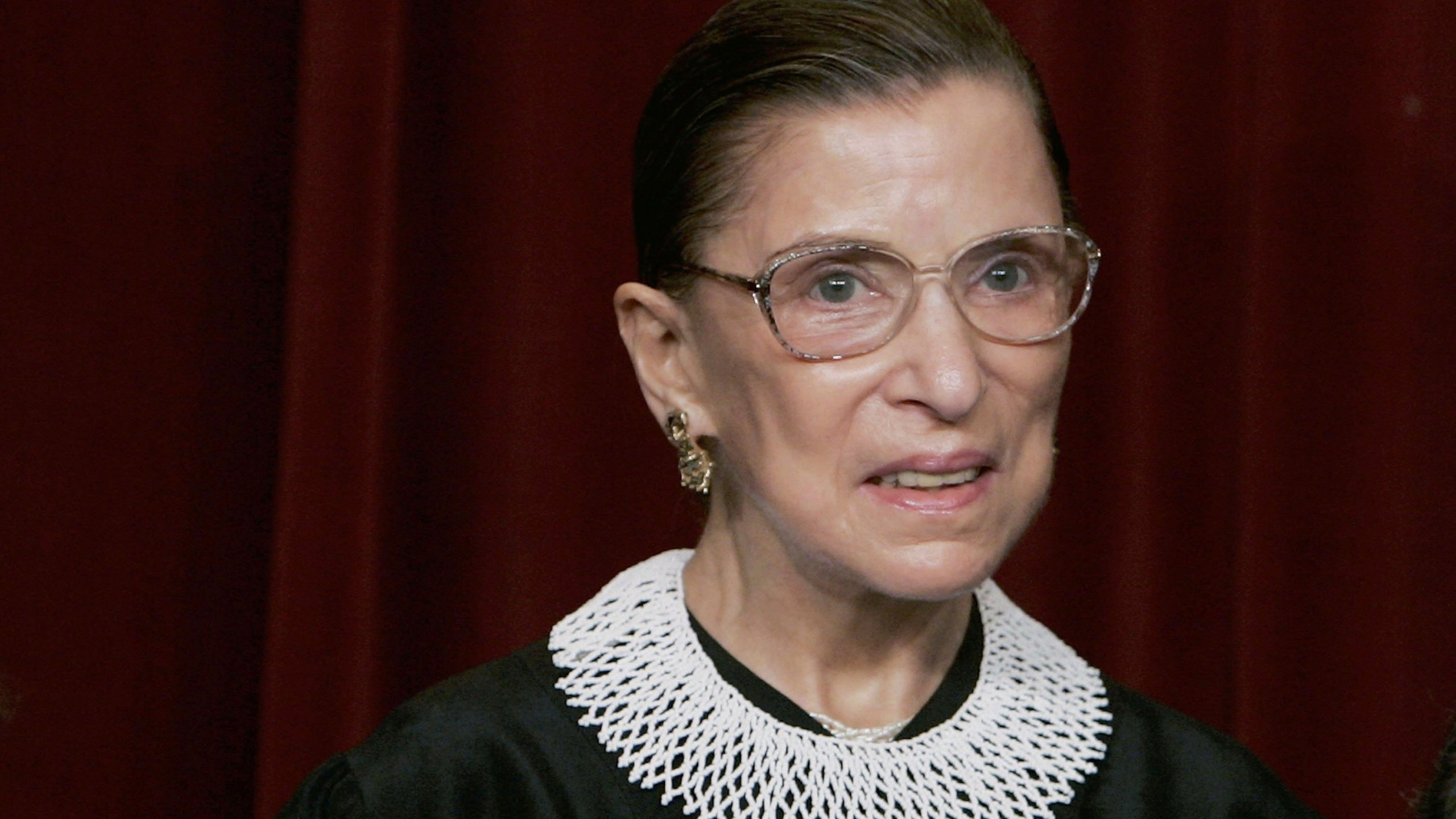 Supreme Court Justice Ruth Bader Ginsburg smiles during a photo session with photographers at the U.S. Supreme Court on March 3, 2006. (Mark Wilson / Getty Images)