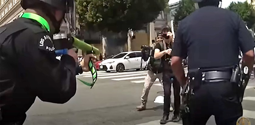 Body-camera video from the Los Angeles Police Department released on Sept. 18, 2020 shows an officer shooting a demonstrator in the groin with a projectile at close range during a protest in Hollywood on June 2, 2020. (LAPD)
