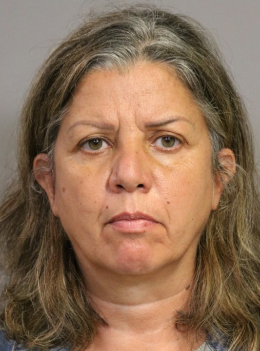 Rima Abikaram is seen in a booking photo released by Costa Mesa police.