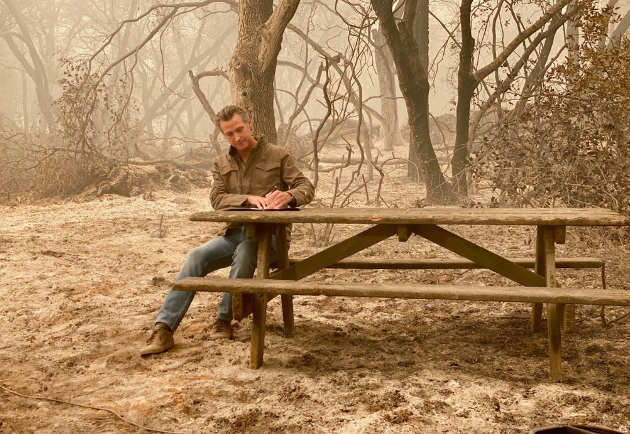 Gov. Gavin Newsom is seen while surveying damage from the North Complex Fire on Sept. 11, 2020.