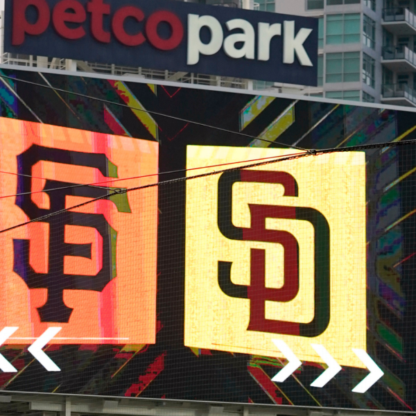 Signs for the San Diego Padres and San Francisco Giants are seen at Petco Park in San Diego on Friday, Sept. 11, 2020, in San Diego. (AP Photo/Gregory Bull)
