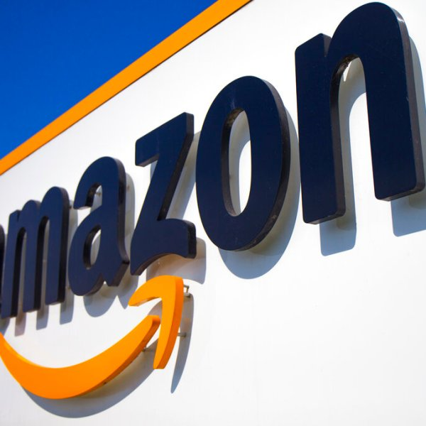 In this Thursday April 16, 2020 file photo, The Amazon logo is seen in Douai, northern France. Amazon is looking to kickstart holiday shopping early this year. The company said Monday, Sept. 28, 2020 that it will hold its annual Prime Day sales event over two days in October That's because the pandemic forced it to be postponed from July. It's the first time the sales event is being held in the fall. (AP Photo/Michel Spingler, File)