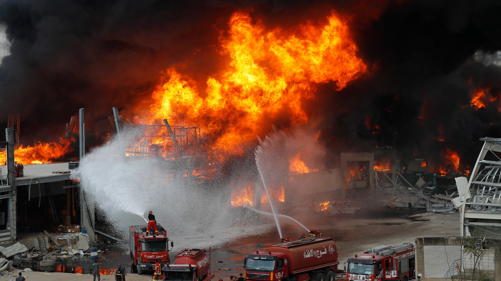 Fire burns in the port in Beirut, Lebanon, Thursday, Sept. 10. 2020. A huge fire broke out Thursday at the Port of Beirut, triggering panic among residents traumatized by last month's massive explosion that killed and injured thousands of people. (AP Photo/Hussein Malla)