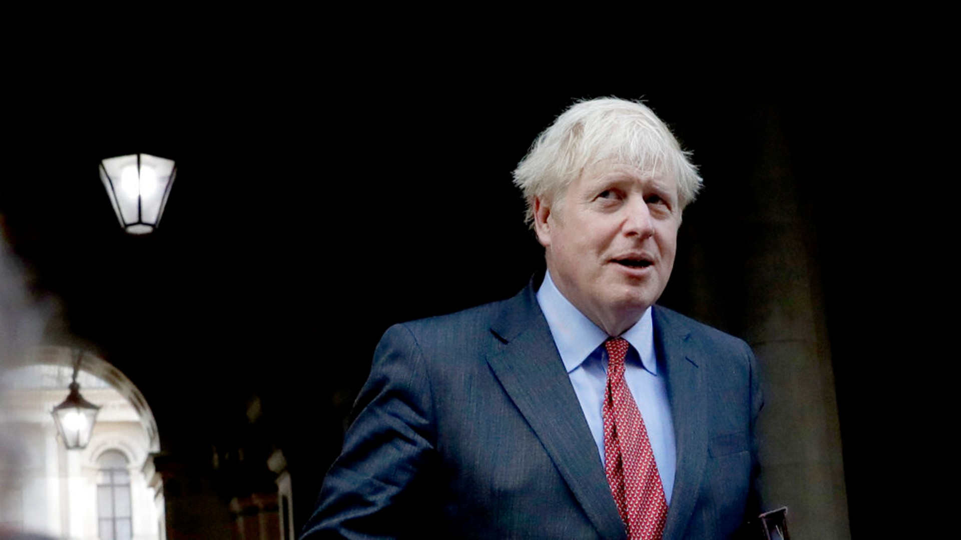 British Prime Minister Boris Johnson walks back into Downing Street after attending a cabinet meeting at the Foreign and Commonwealth Office in London, Tuesday, Sept. 22, 2020. (AP Photo/Matt Dunham)
