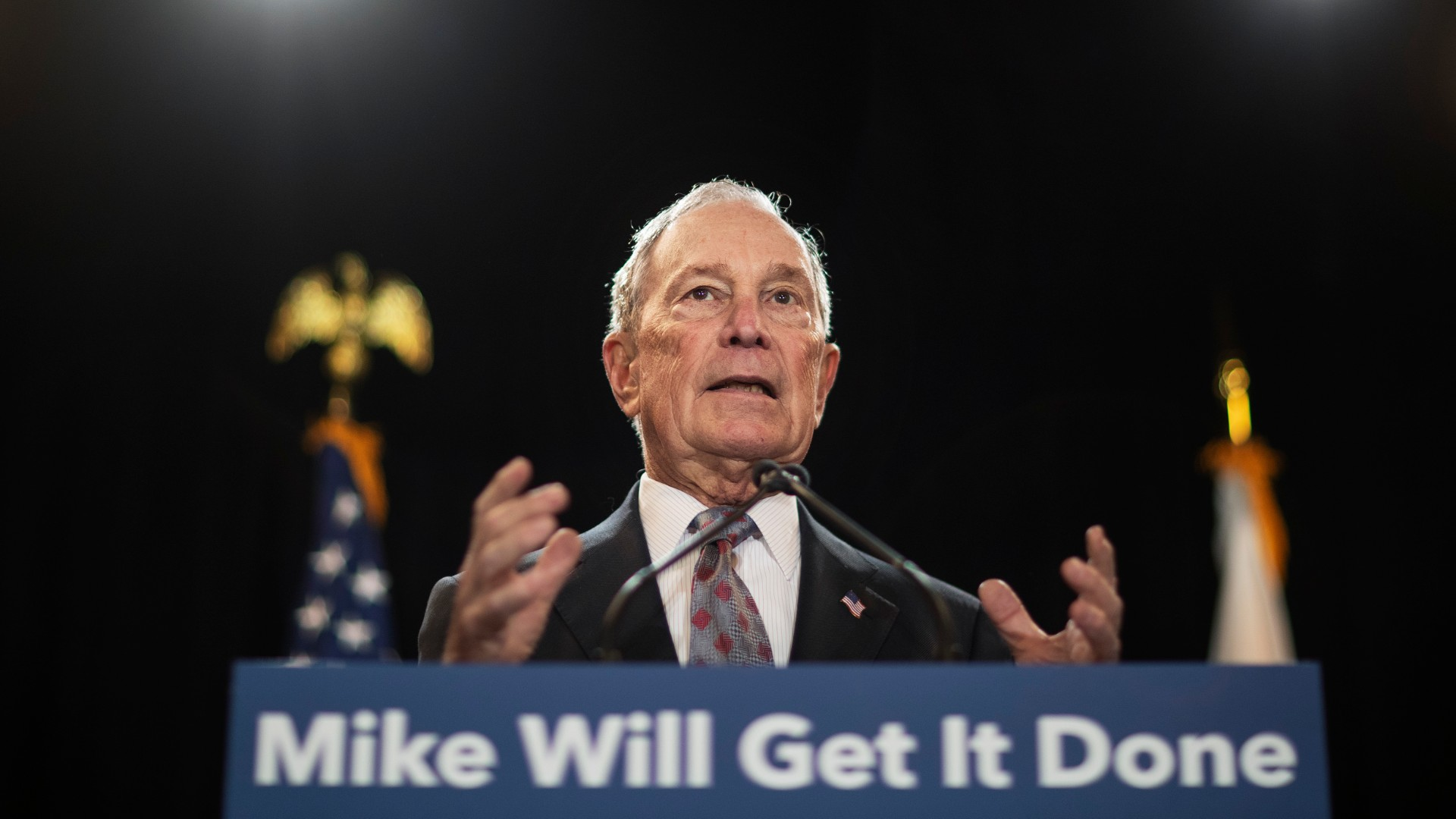 """In this Feb. 5, 2020, file photo, then-Democratic presidential candidate and former New York City Mayor Michael Bloomberg speaks at a campaign event in Providence, R.I. Bloomberg has come through on his vow to spend """"whatever it takes"""" to defeat President Donald Trump. (AP Photo/David Goldman, File)"""