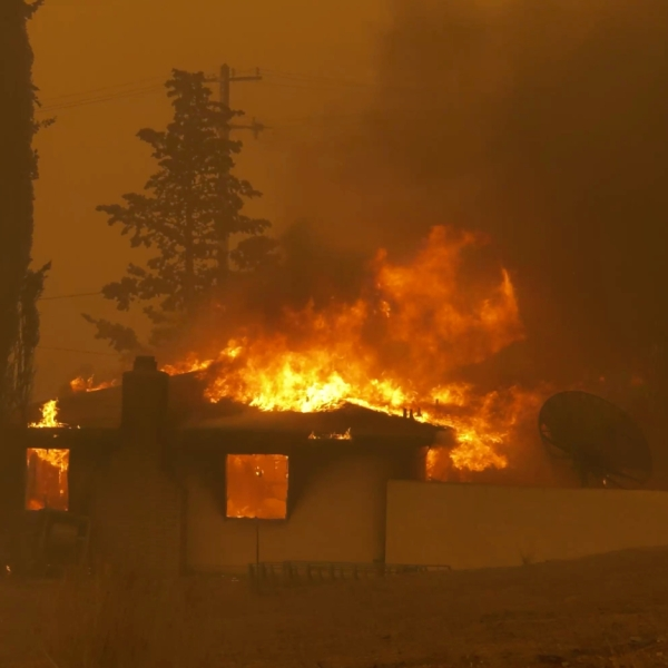 A home burns in the Juniper Hills area during the Bobcat Fire on Sept. 18, 2020. (RMG News)