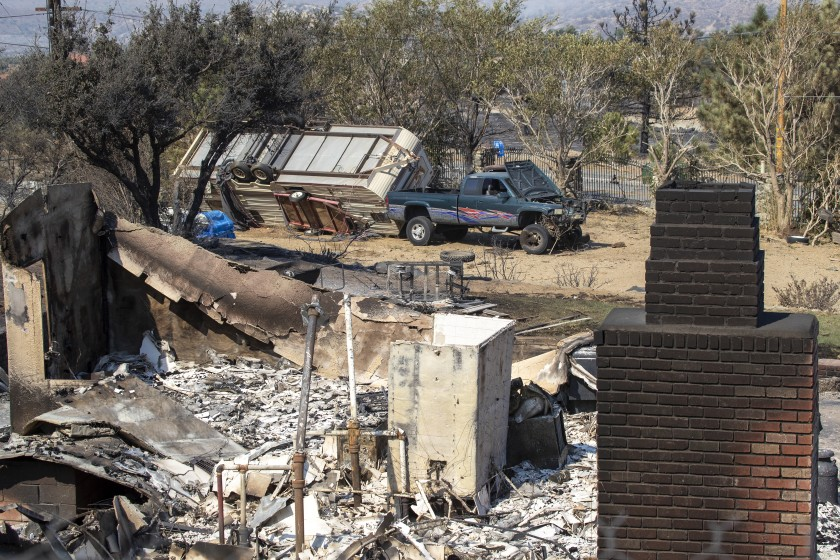 """The broad confluence of factors that you got there in California — the Meditteranean climate, the [dead trees] in the Sierra and then over 2 million properties at risk — shouldn't be a surprise,"" Harbour said. ""It's trite to say ... this isn't the worst of it."" This photo shows a home in Juniper Hills that was destroyed by the Bobcat Fire.(Allen J. Schaben / Los Angeles Times)"
