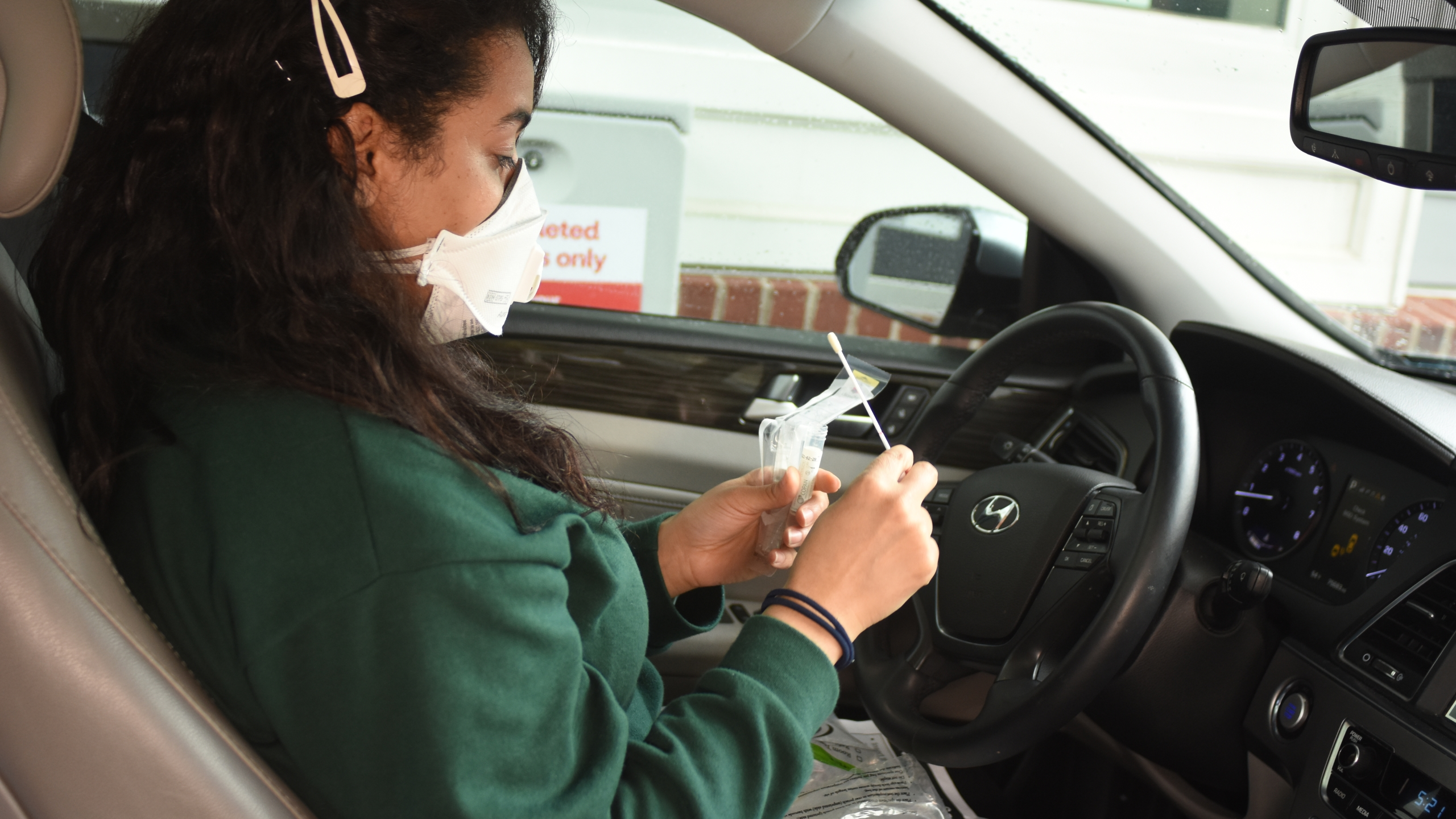 A patient at a self-swab COVID-19 testing site at a CVS Pharmacy. (CVS Health Newsroom)