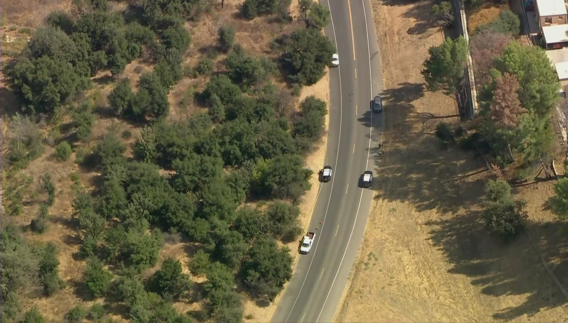 Los Angeles County Sheriff's Department patrol vehicles are seen near where a body was found in Agoura Hills on Sept. 24, 2020. (KTLA)