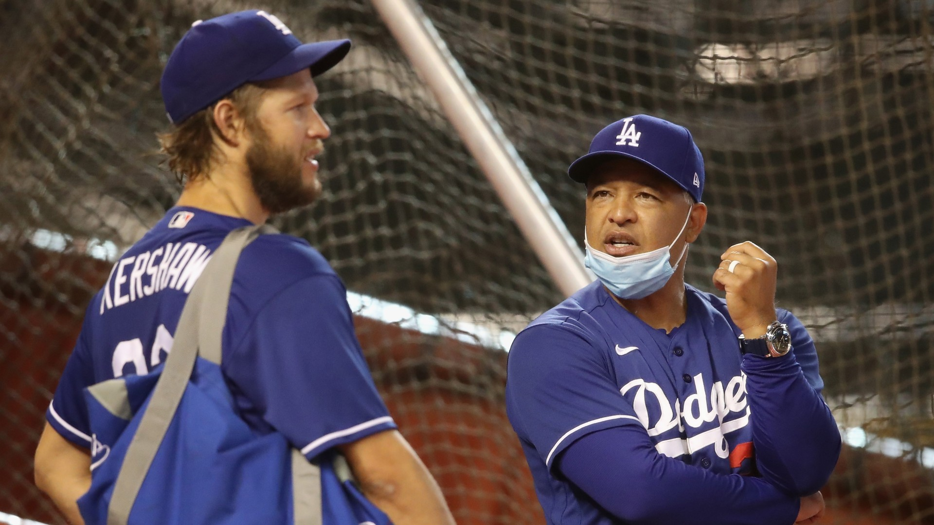 Manager Dave Roberts of the Los Angeles Dodgers talks with pitcher Clayton Kershaw before the MLB game against the Arizona Diamondbacks at Chase Field on July 30, 2020 in Phoenix, Arizona. (Photo by Christian Petersen/Getty Images)