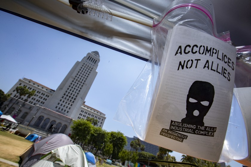 Sheriff's deputies cleared out a protest encampment in downtown L.A.'s Grand Park, across from City Hall, early Sunday.(Brian van der Brug / Los Angeles Times)