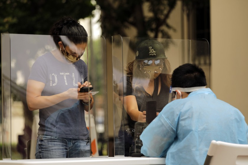 The rate of Californians testing positive for COVID-19 has continued to fall even as the state has opened new options, including a walk-up kiosk at Los Angeles Union Station that can conduct 500 tests per day. (Myung J. Chun / Los Angeles Times)