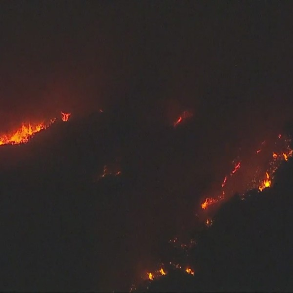 The El Dorado Fire continues tearing through San Bernardino County on Sept. 6, 2020, after erupting in Yucaipa the day before. Authorities said the wildfire was caused by a mishap at a gender reveal party. (KTLA)