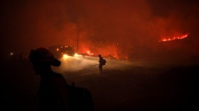Firefighters put out embers from the El Dorado fire earlier this month.(Wally Skalij / Los Angeles Times)