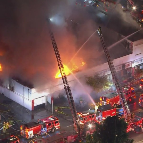 Crews battle a fire at a commercial building in South Los Angeles on Sept. 16, 2020. (KTLA)