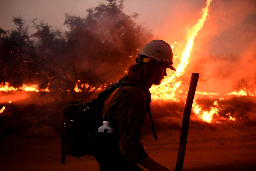A firefighter helps to set back fires as the El Dorado fire approaches in Yucaipa, Calif., on Monday. (Wally Skalij / Los Angeles Times)