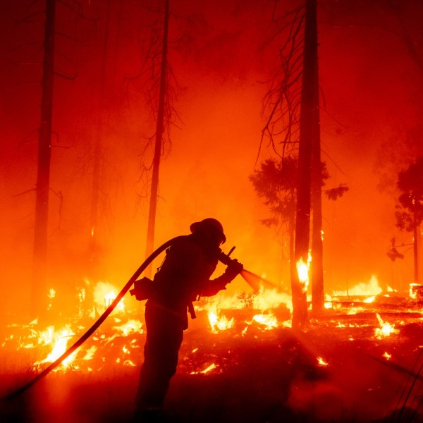 In this Sept. 7, 2020, file photo, a firefighter battles the Creek Fire as it threatens homes in the Cascadel Woods neighborhood of Madera County, Calif. (AP Photo/Noah Berger,File)