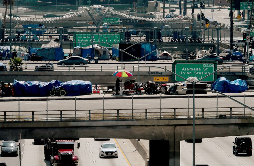 Homeless camps line Los Angeles, Main and Spring streets as they cross over the Hollywood Freeway in downtown Los Angeles.(Luis Sinco / Los Angeles Times)