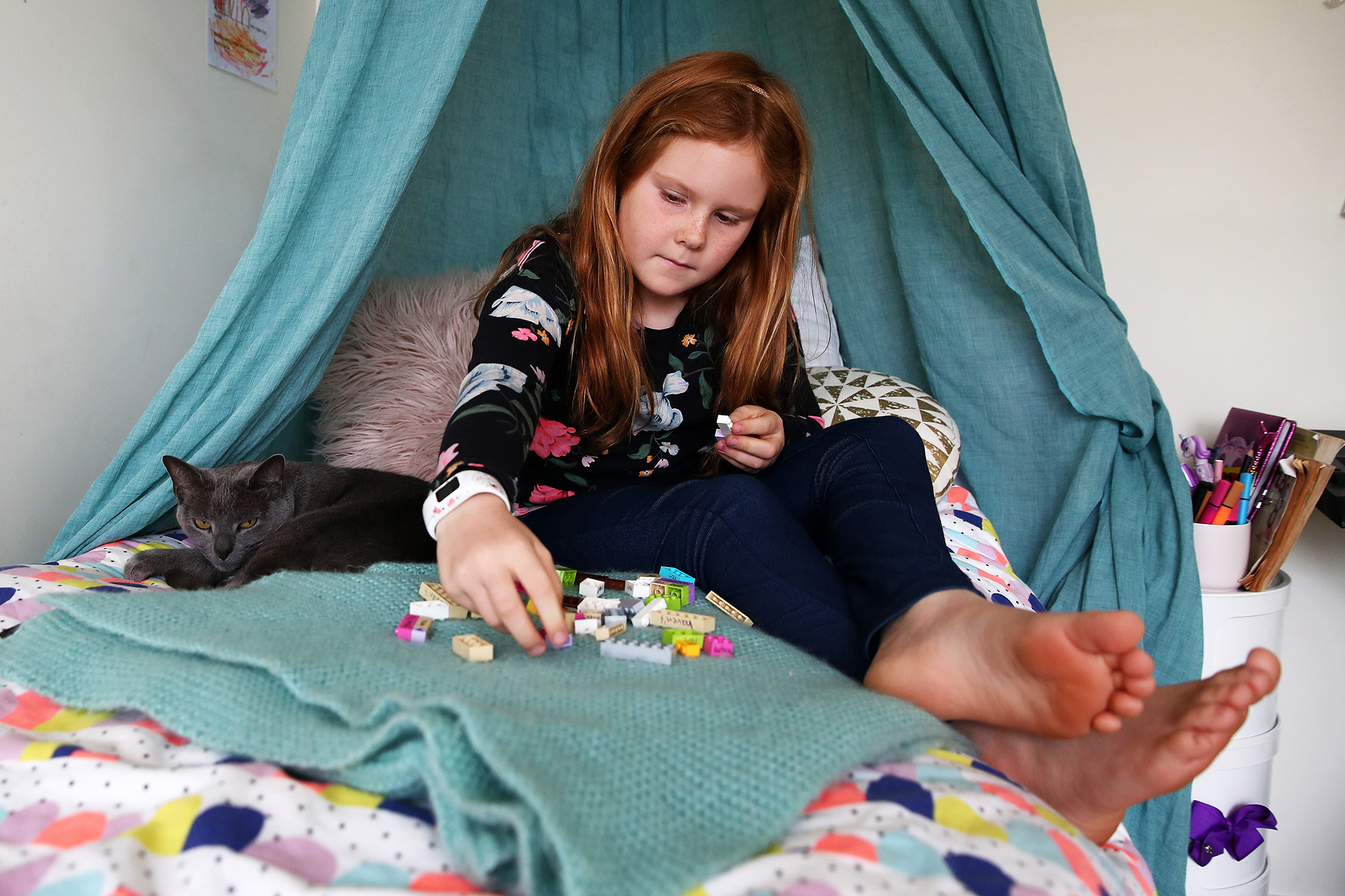Nina Goodall, 8, works on a lesson in contraction words using Lego her mum made after seeing an example online. (Fiona Goodall/Getty Images via CNN Wire)